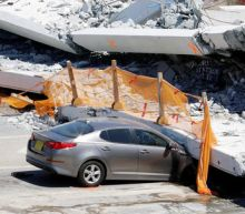 Students return to Miami school where bridge collapse killed six