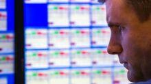 Wall Street sinks on trade jitters ahead of Powell speech