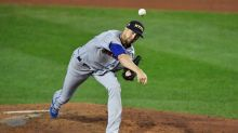 DeGrom, in NYPD hat, backed by 10-run 4th, Mets rout Jays