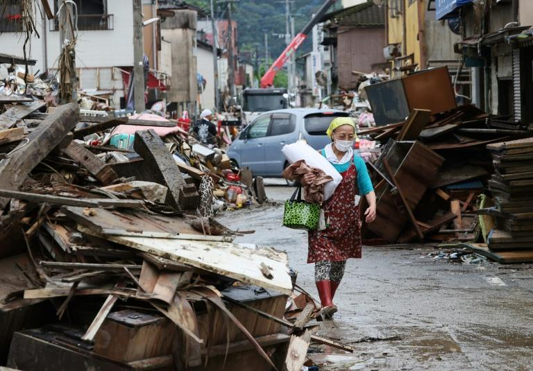 At least 72 people are confirmed to have died in torrential rains in Japan that triggered flooding and landslides
