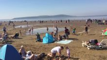 Hottest day of the year sees Brits hit beach in Weston-super-Mare