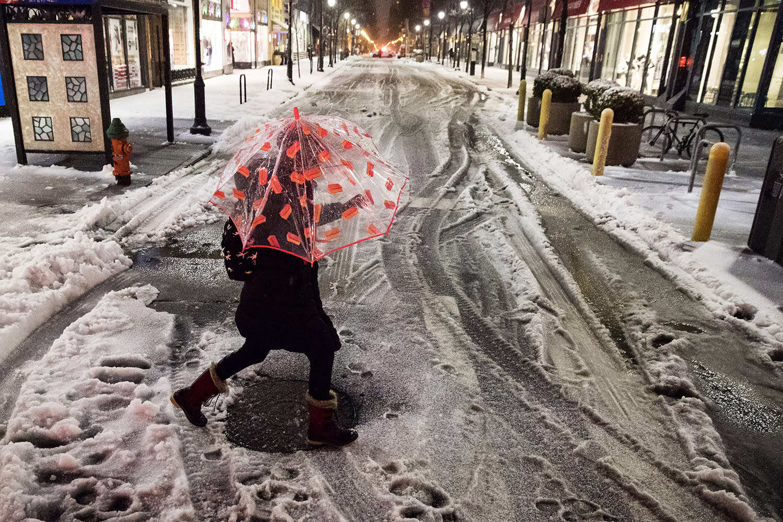 <p>A woman crosses a street during a winter storm in Philadelphia, Tuesday, March 14, 2017. (Matt Rourke/AP) </p>