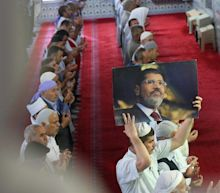 Mohammed Morsi swiftly buried after being denied public funeral in hometown