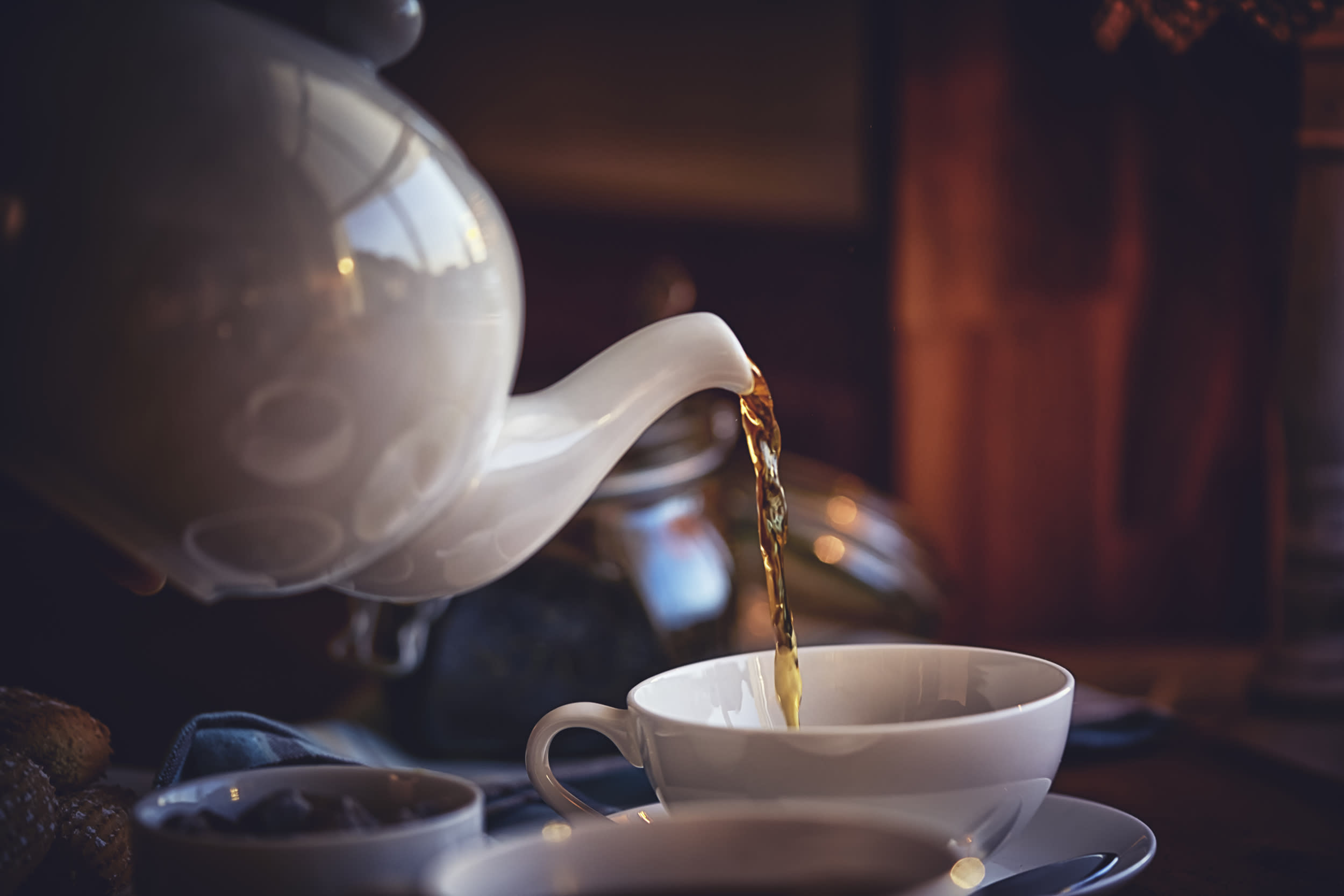 Pouring Black Tea into Cup