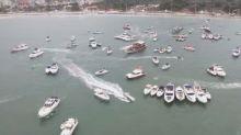 Em meio à pandemia, festa tem barcos de luxo e dinheiro jogado ao mar no litoral de SP