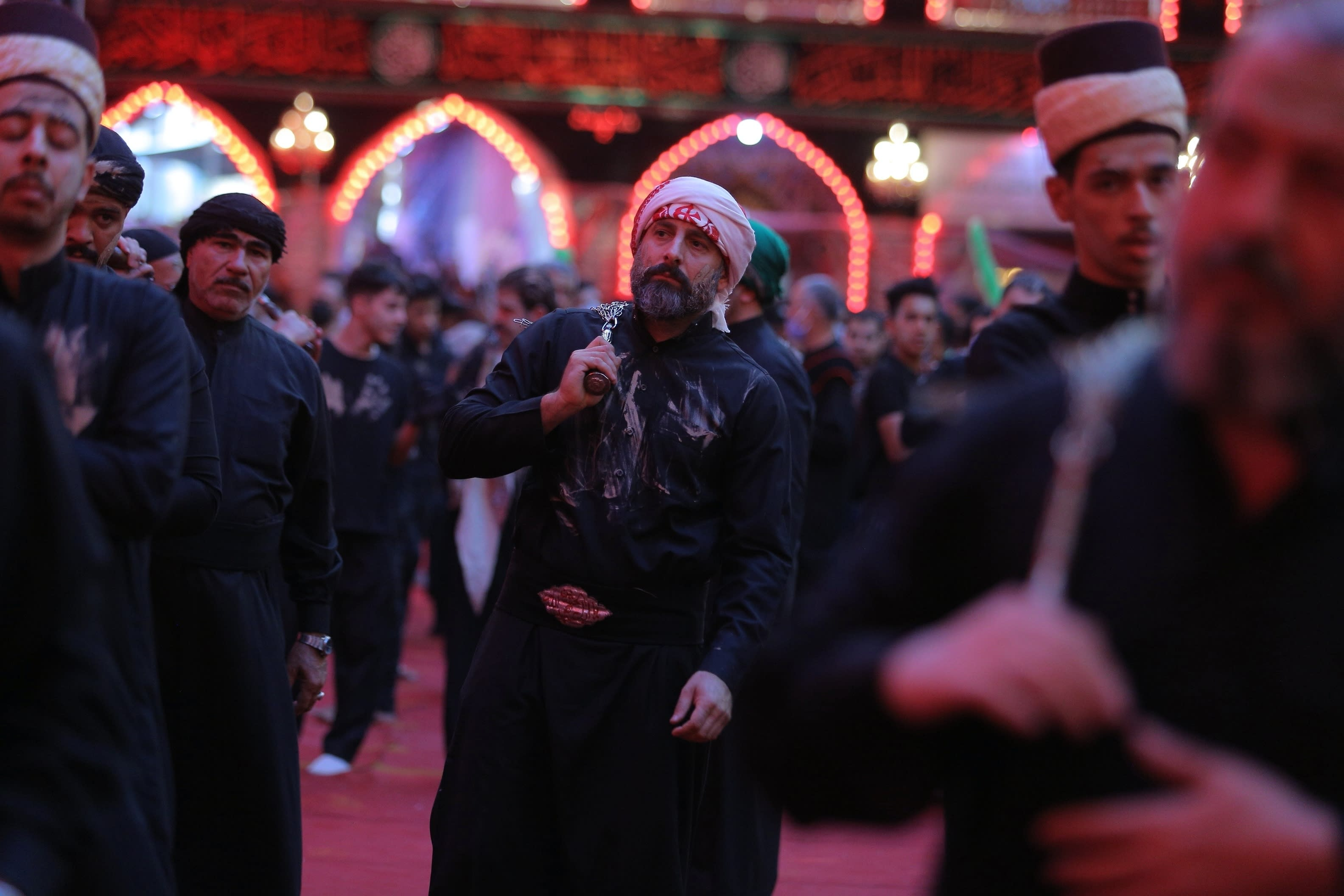 Shiite Muslim worshippers perform their rituals inside the holy shrine of Imam Hussein during the Muharram procession in Karbala, Iraq, Saturday, Aug. 29, 2020. Saturday, Aug. 29, 2020. The holiday marks the end of the forty day mourning period after the anniversary of the martyrdom of Imam Hussein, the Prophet Muhammad's grandson in the 7th century. (AP Photo/Anmar Khalil)