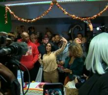 Cardi B swarmed as she hands out free winter coats in Brooklyn