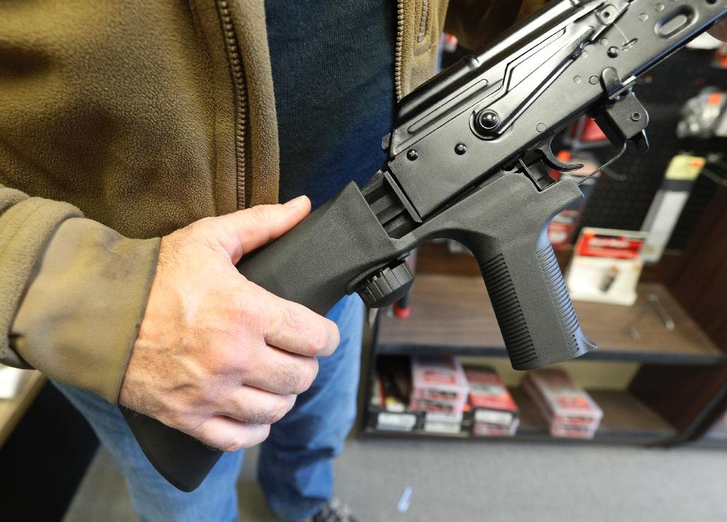 Bump stock devices, which attach to semi-automatic rifles to increase the speed at which they can be fired, are at the center of a debate over what steps should be taken to address repeated mass shootings in the United States (AFP Photo/GEORGE FREY)