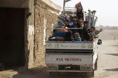 Internally displaced refugees that fled violence ride a pick-up truck in al-Kherbeh village, northern Aleppo province, Syria October 24, 2016. REUTERS/Khalil Ashawi