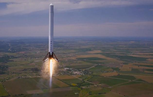 Watch SpaceX's reusable rocket hover at 3,280 feet before gently landing back to Earth