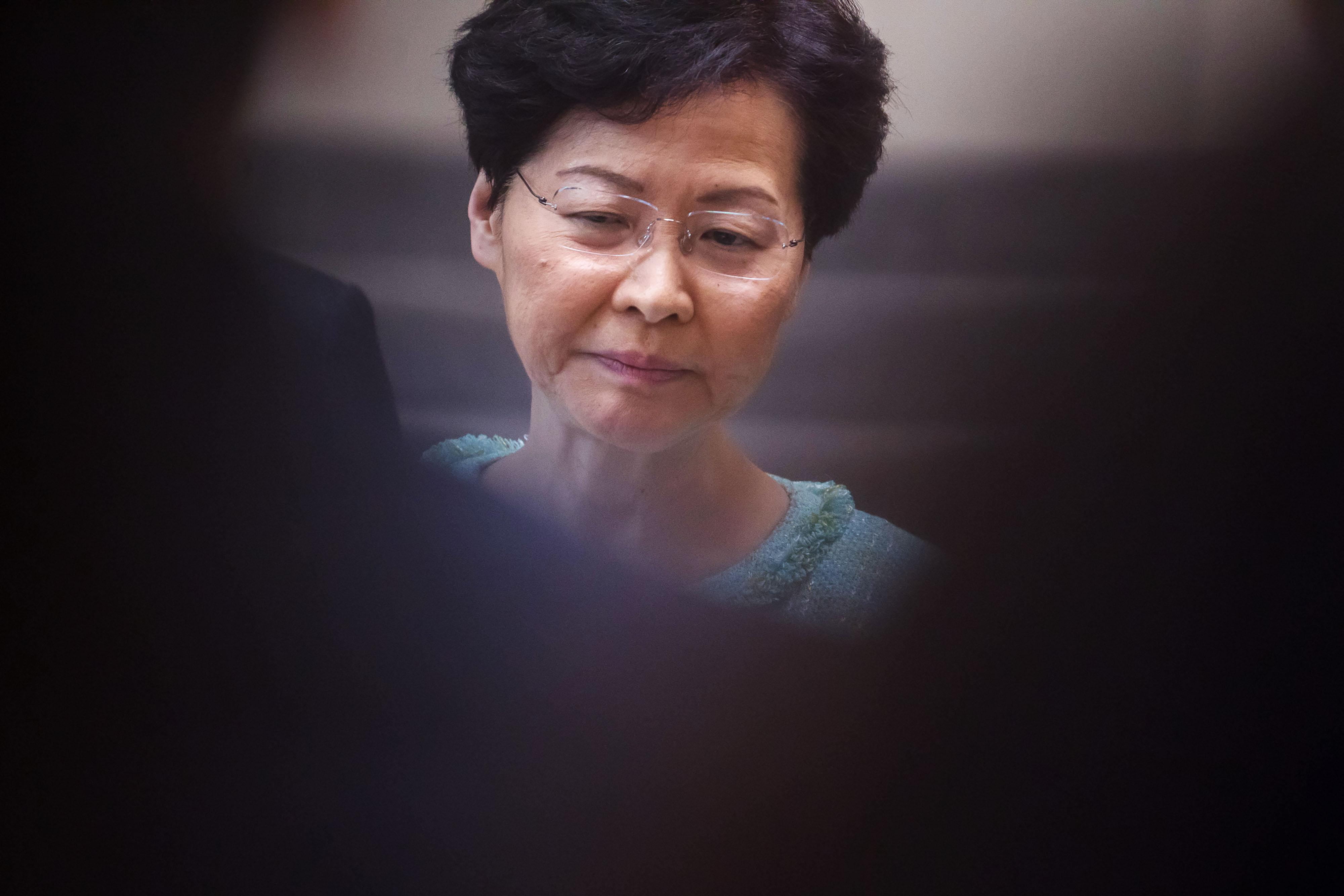 Hong Kong Leader Defends Police, Dodges Questions and Chokes Up in Press Briefing