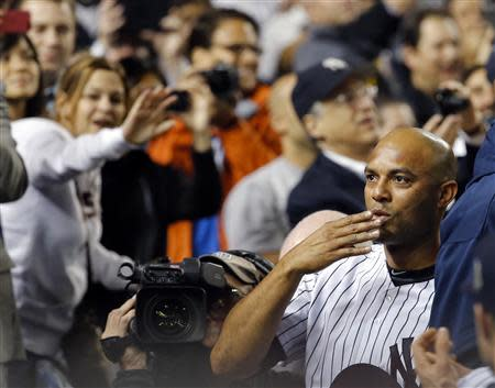 New York Yankees relief pitcher Mariano Rivera blows a kiss to the crowd as they applaud him as he leaves the game with the Tampa Bay Rays in New York