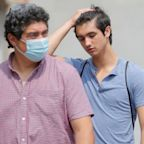 CDC urges vaccinated people in covid hot spots to resume mask wearing indoors