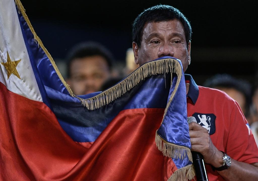 Philippine President-elect Rodrigo Duterte (pictured) is planning to visit the Vatican to make a personal apology to the pope for calling him a 'son of a whore' (AFP Photo/Mohd Rasfan)