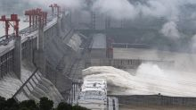 Floods kill 14 in China as water peaks at Three Gorges Dam