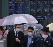 Asian markets climb after Wall Street halts its skid