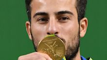 Olympic Weightlifter To Sell Gold Medal For Iran's Earthquake Victims