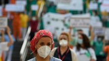Spain health workers protest at virus shortages
