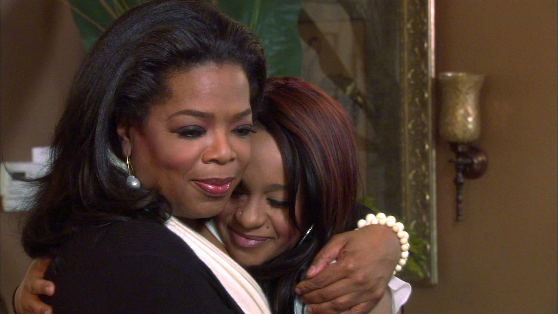 """FILE - An undated image from video originally released by Harpo, Inc., shows host Oprah Winfrey, left, embracing Bobbi Kristina, daughter of the late singer Whitney Houston during an interview in Atlanta, Ga. The exclusive interview was shown on """"Oprah's Next Chapter,"""" on the OWN network on March 11, 2012. (AP Photo/Harpo, Inc., file)"""