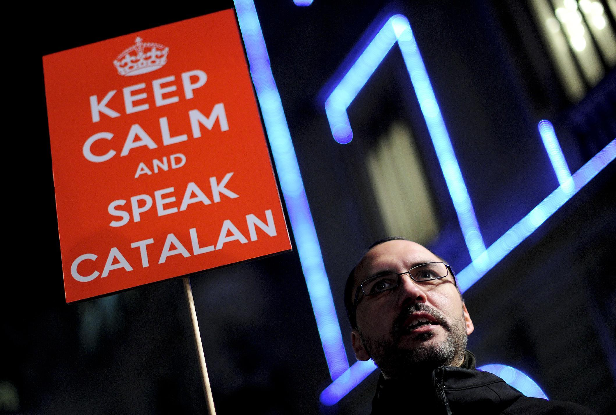 A man holds a banner during a protest in defence of Catalan language and against Education Minister Jose Ignacio Wert in Barcelona on December 10, 2012 (AFP Photo/Josep Lago)