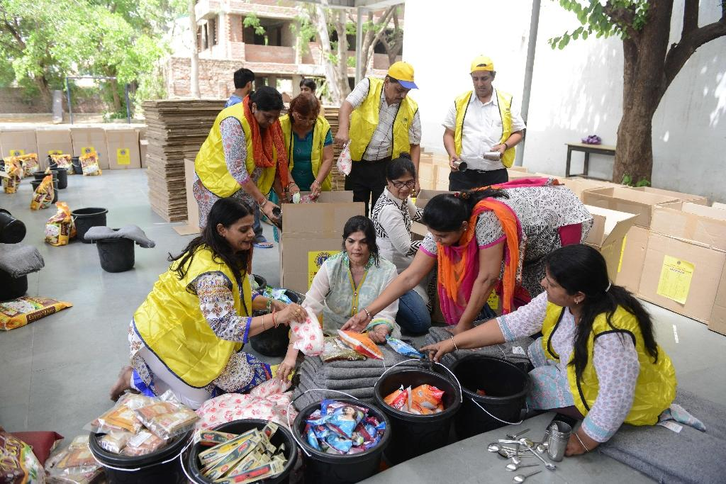 Indian volunteers pack relief materials to be sent to Nepal's earthquake affected people, in Ahmedabad on May 2, 2015 (AFP Photo/Sam Panthaky)