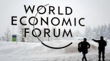 Merkel, Macron take Davos spotlight ahead of Trump show