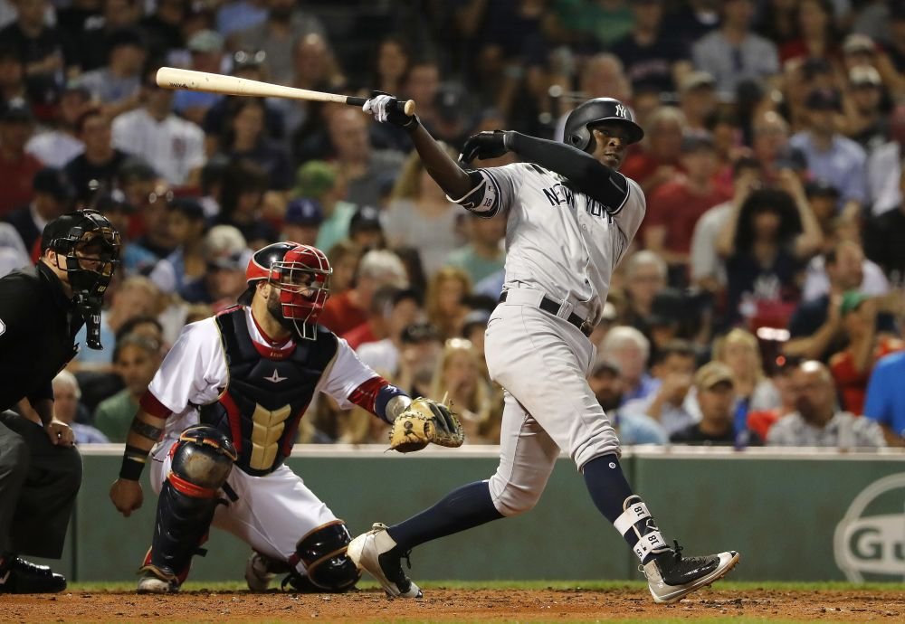 Didi Gregorius follows through on one of his 20 home runs during the 2017 season. (AP)