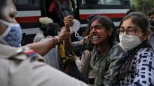 Protests rumble in India over alleged gang-rape of young woman
