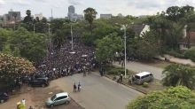 The Latest: Zimbabweans gather in thousands near State House