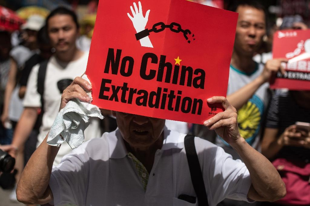 Hong Kong businesses pledge closures as extradition anger builds