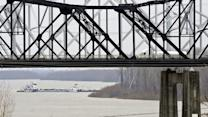 Barge Hits Miss. River Bridge; Cleanup Ongoing