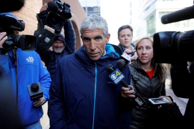 Employee of U.S. college admissions scandal's mastermind to plead guilty