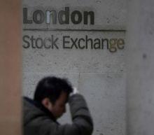 Investors shrug off U.S. government shutdown, dollar dips