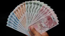 Turkish lira firms against dollar as U.S. standoff drags on