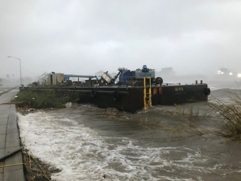 A Skanska company barge run aground along Bayfront Parkway from winds of Hurricane Sally is seen in Pensacola