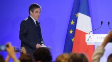 Fillon faces 'fake job' charges but stays in French campaign