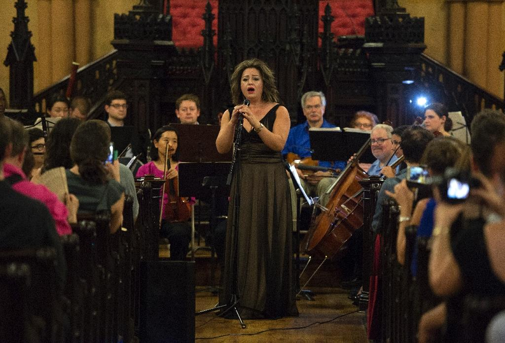 Lubana al-Quntar, a Syrian opera singer who was granted asylum in the United States, sings with the Refugee Orchestra Project on World Refugee Day, at the First Unitarian Congregational Society in Brooklyn, New York, on June 20, 2016 (AFP Photo/Don Emmert)