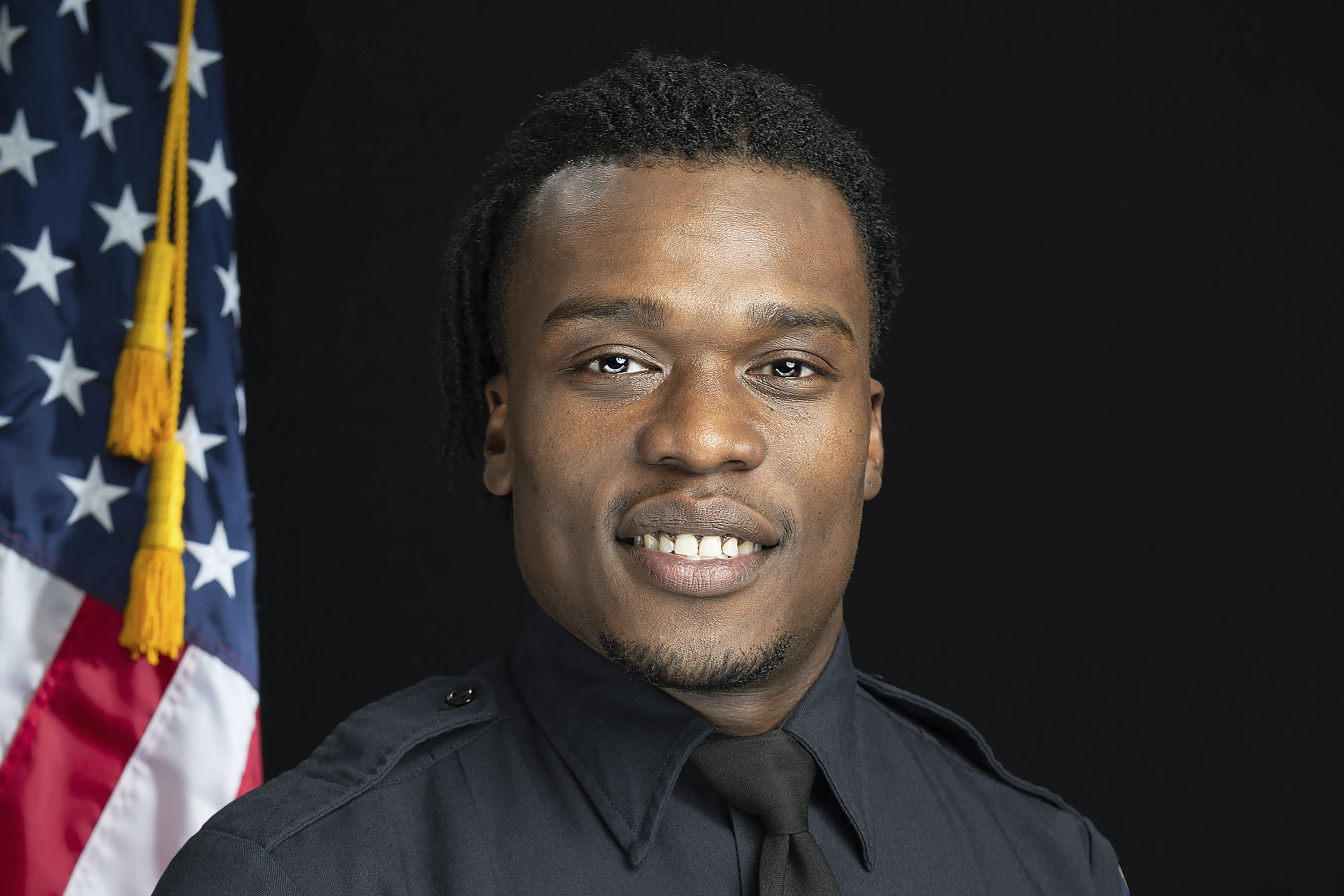 This undated photo provided by the Wauwatosa Police Department in Wauwatosa, Wis., shows Wauwatosa Police Officer Joseph Mensah. In a report released Wednesday Oct. 7, 2020, an independent investigator recommended officials in the Milwaukee suburb fire Mensah, who has shot and killed three people in the last five years. (Gary Monreal/Monreal Photography LLC/Wauwatosa Police Department via AP)