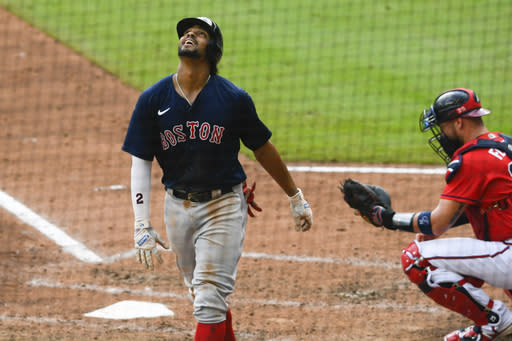 Boston Red Sox Xander Bogaerts looks skyward after hitting a home run to center field as Atlanta Braves catcher Tyler Flowers waits for the next batter during the fifth inning of a baseball game Sunday, Sept. 27, 2020, in Atlanta. (AP Photo/John Amis)