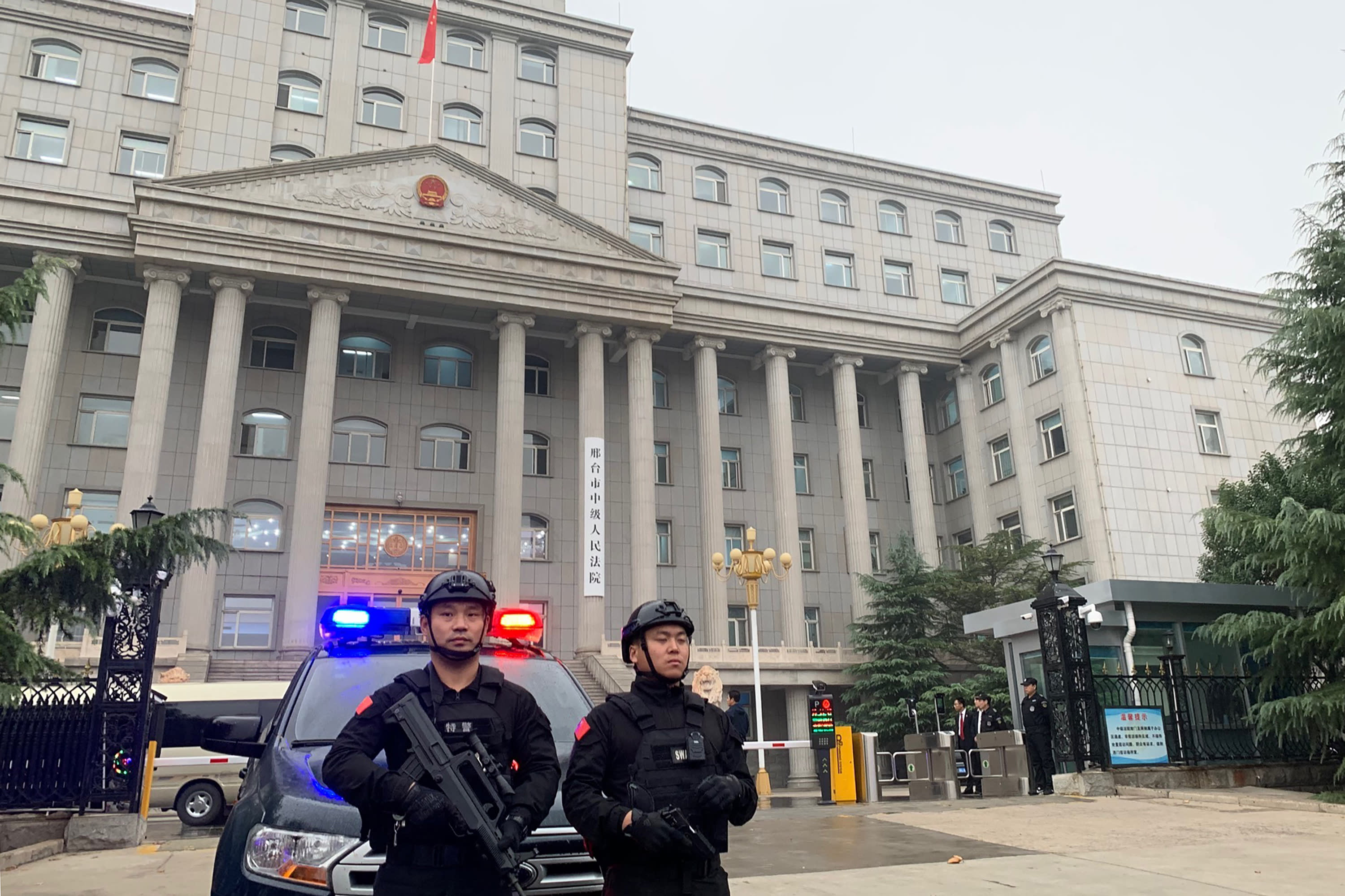 China jails nine for selling fentanyl into US