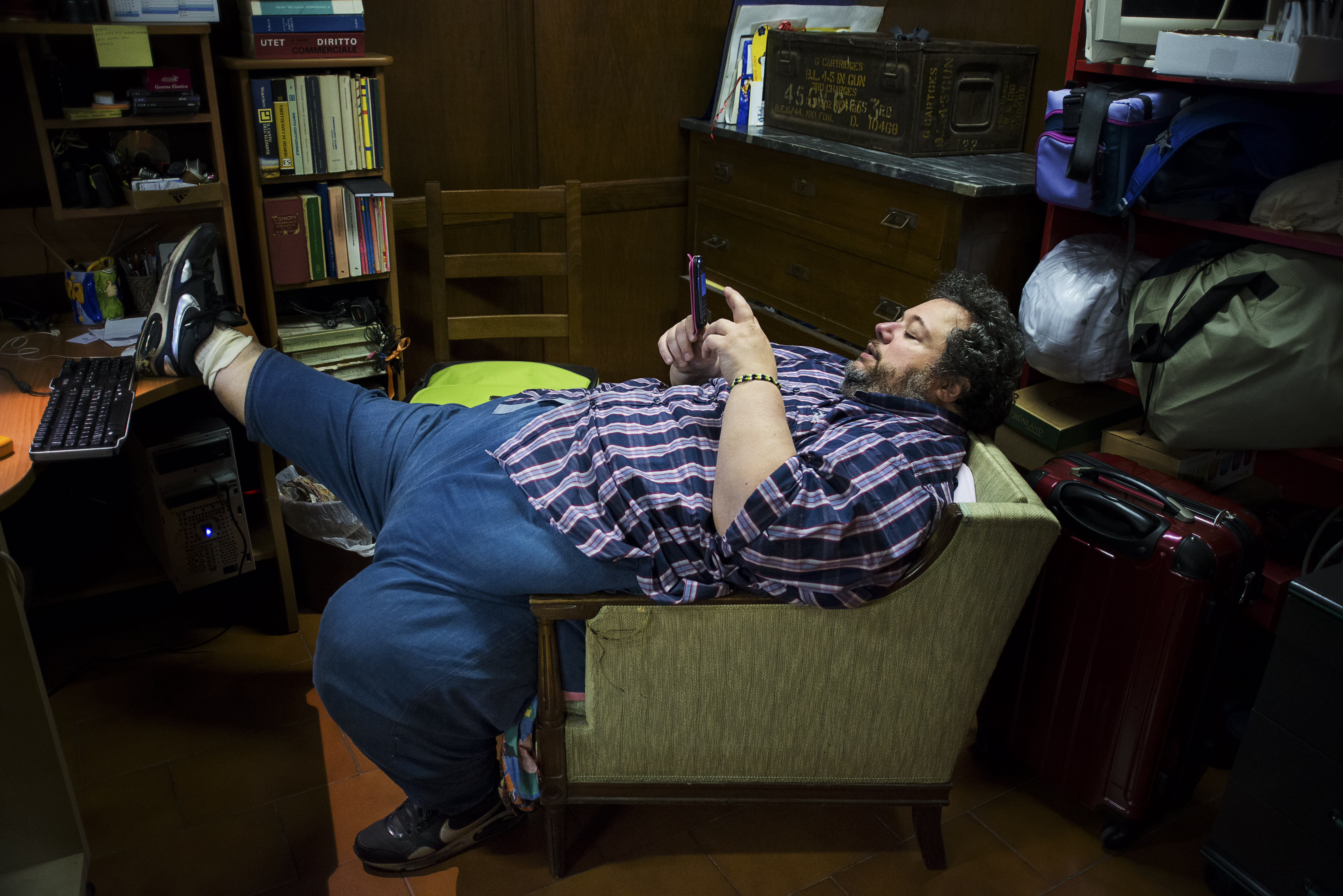 <p>Giovanni Calacione, 47, in his home. Calacione has suffered from severe obesity for many years and his weight has fluctuated, reaching as high as 661 lbs. He has always battled against his body, and obesity has deeply influenced his emotional and work life, he says. (Photograph by Silvia Landi) </p>