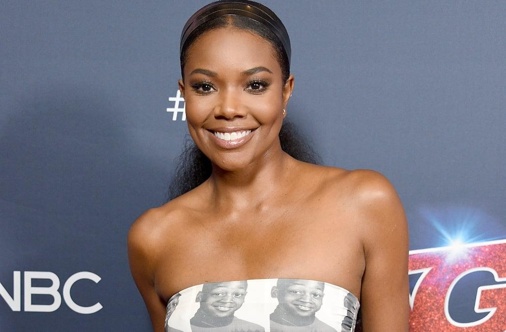Gabrielle Union stuns in a dress with Dwyane Wade's face on it