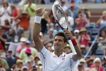 Novak Djokovic of Serbia reacts after defeating Sam Querrey of the U.S. at the 2014 U.S. Open tennis tournament in New York