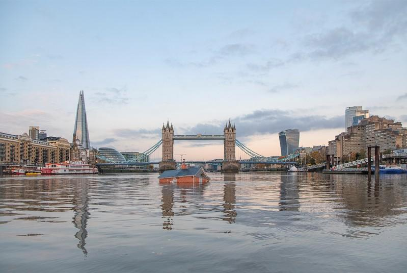 Mock-up of typical British suburban home is seen sinking into River Thames in London