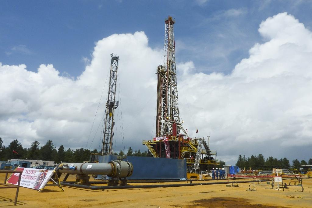 A Venezuelan default could trigger a global rush to seize assets owned by the government and state oil company PDVSA, one of whose oil wells is seen in Morichal in 2011 (AFP Photo/RAMON SAHMKOW)