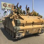 Kurds evacuate Syrian town in 1st pullout of cease-fire