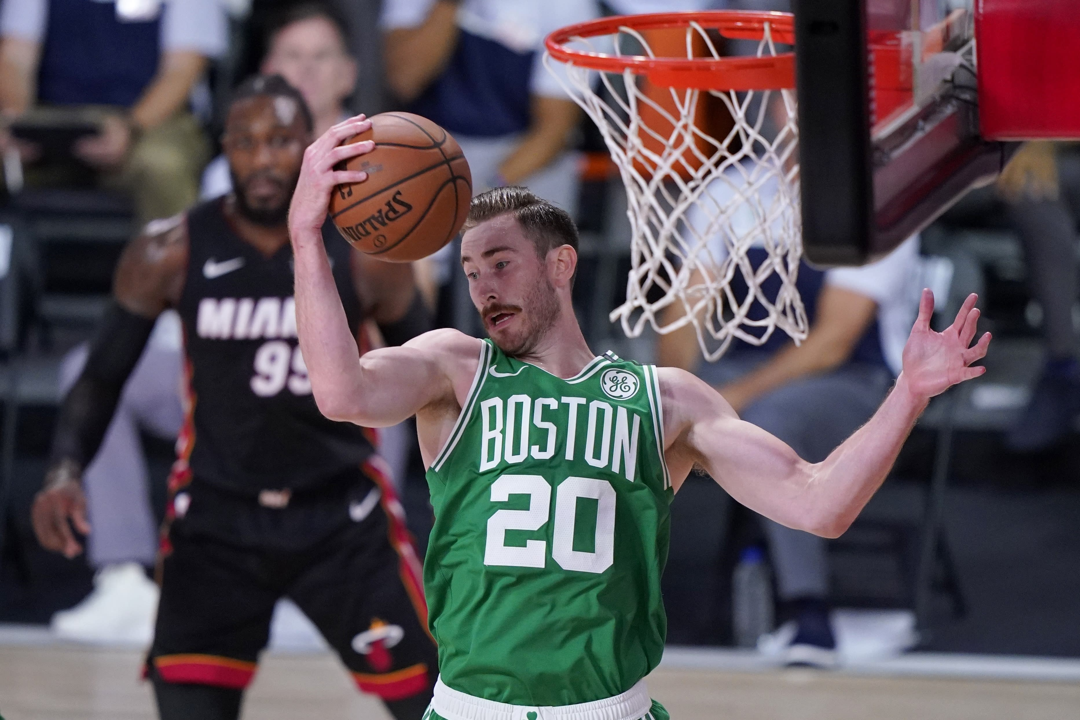 Boston Celtics forward Gordon Hayward (20) comes down with a rebound during the first half of an NBA conference final playoff basketball game against the Miami Heat on Saturday, Sept. 19, 2020, in Lake Buena Vista, Fla. (AP Photo/Mark J. Terrill)