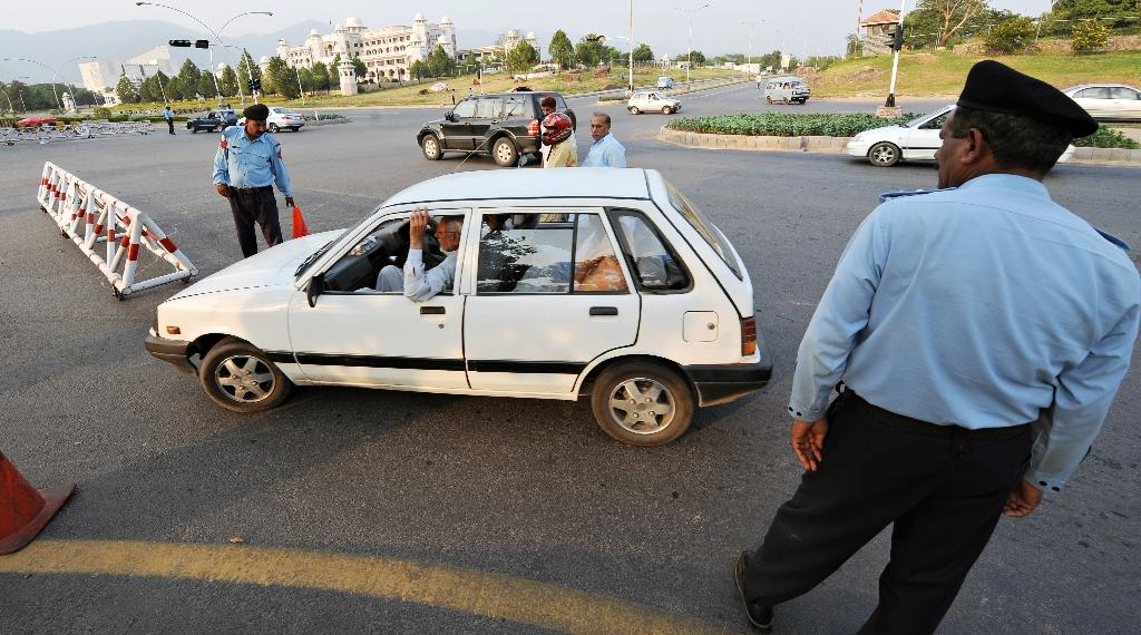 Pakistani police officers man a checkpoint in Islamabad on October 2, 2008