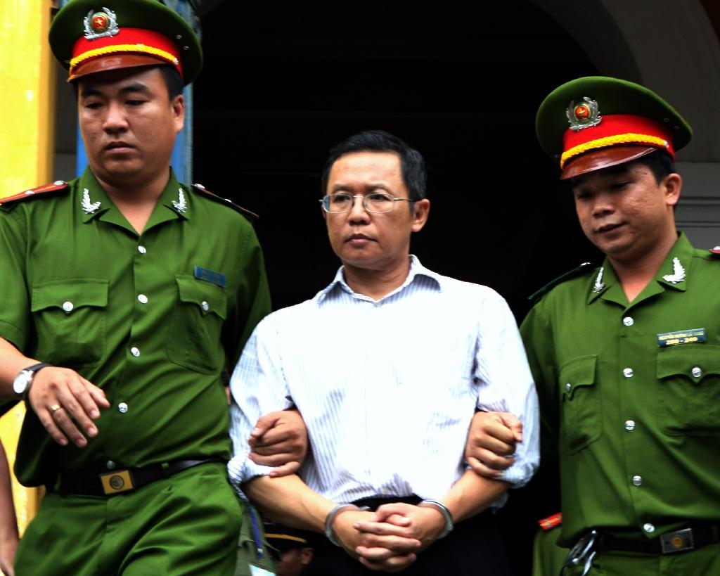 Pham Minh Hoang is led from a courtoom in 2011 after being jailed for three years: he has now been stripped of his citizenship and deported