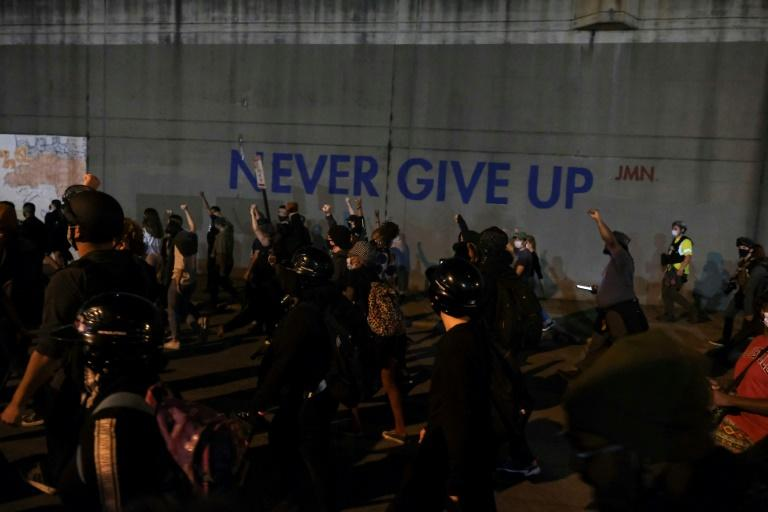 Protestors march as they protest the lack of criminal charges in the police killing of Breonna Taylor, in downtown Louisville, Kentucky on September 24, 2020